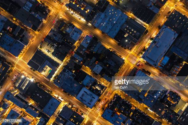 aerial view of san francisco night cityscape during the blue hour after sunset (dusk) - suspension bridge stock photos and pictures