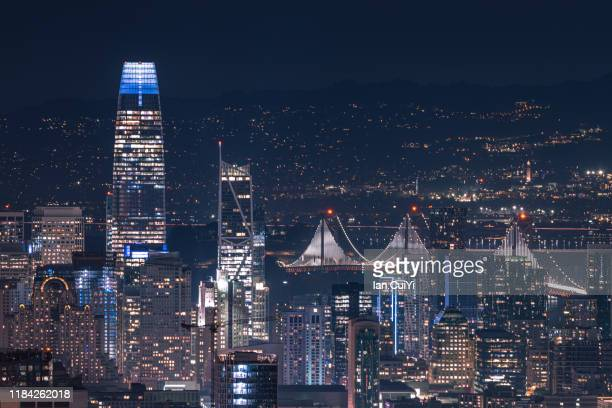 aerial view of san francisco night cityscape during the blue hour after sunset (dusk) - san francisco bay bridge stock pictures, royalty-free photos & images