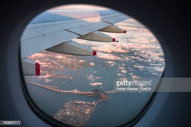 aerial view of san francisco. oakland bay bridge seen from airplane window - treasure island california stock pictures, royalty-free photos & images