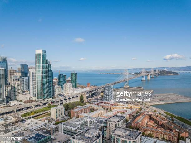 aerial view of san francisco skyline and bay bridge - western usa stock pictures, royalty-free photos & images