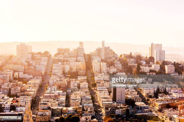 aerial view of san francisco skyline at sunset, california, usa - san francisco california stock pictures, royalty-free photos & images