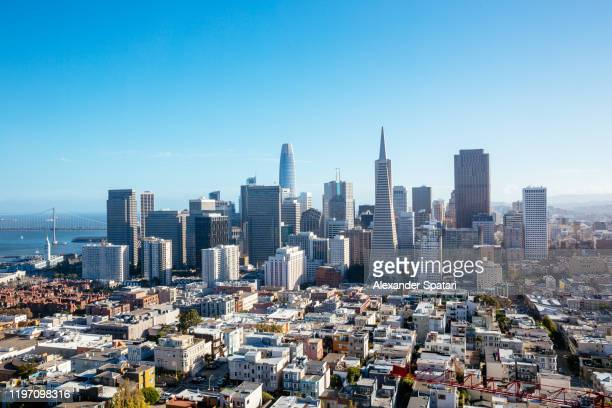 aerial view of san francisco skyline on a sunny day with clear blue sky, california, usa - san francisco bay area stock pictures, royalty-free photos & images
