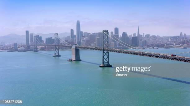 aerial view of san francisco-oakland bay bridge in california, usa - bay bridge stock pictures, royalty-free photos & images
