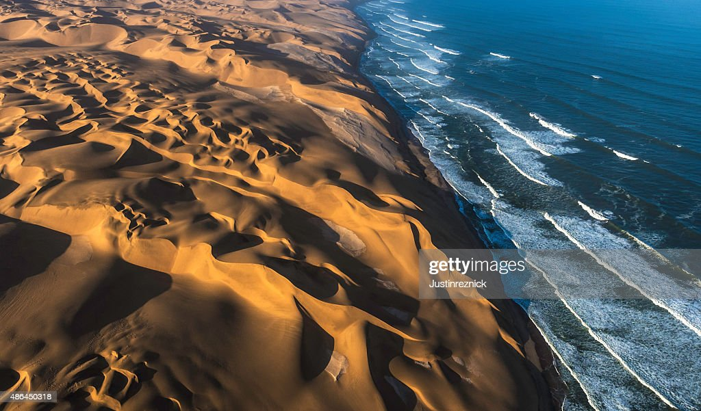 Aerial View of Sand Dunes and Ocean : Stock Photo