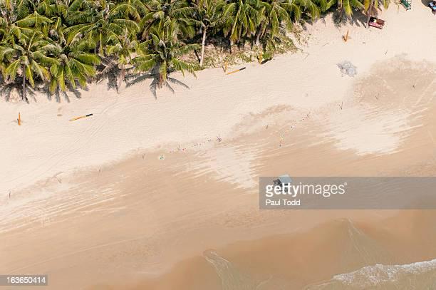 Aerial view of sandy beach and small TukTuk, Sanya, Hainan, China