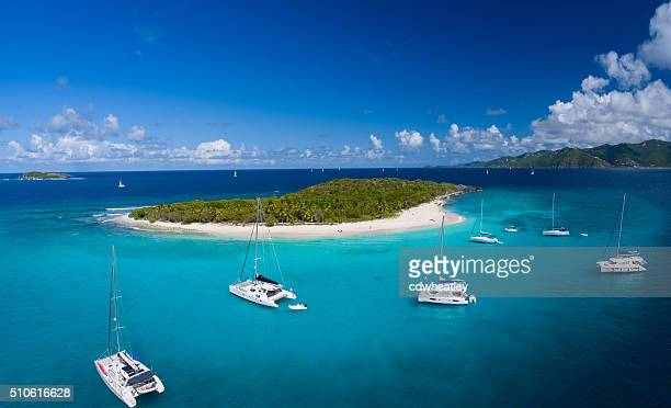 aerial view of sandy cay, british virgin islands - catamaran stock photos and pictures