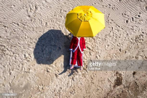 aerial view of santa claus relaxing on the beach. - posizione descrittiva foto e immagini stock