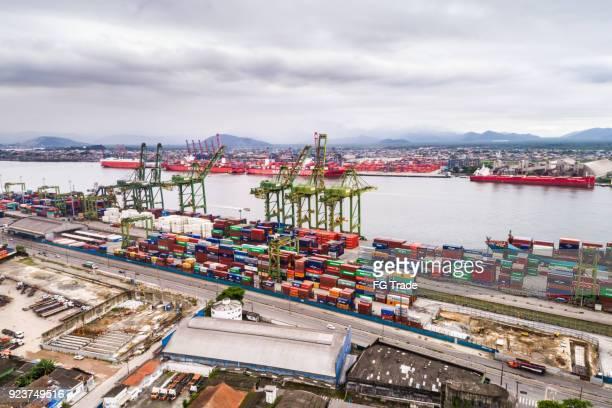 aerial view of santos port in brazil - darsena foto e immagini stock