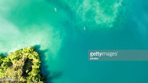 aerial view of sarawandori, yapen (serui) papua indonesia - atoll stock pictures, royalty-free photos & images