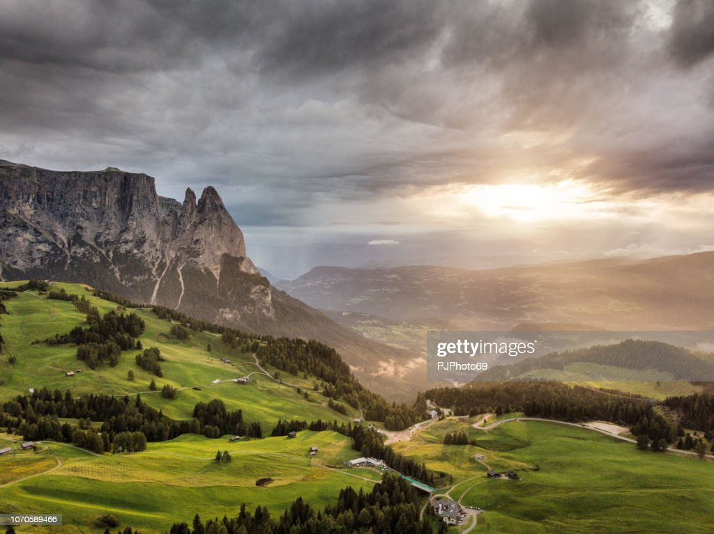 Aerial view of Sciliar mountains with sunlight and dramatic sky - Dolomites : Foto stock