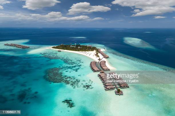 aerial view of sea against blue sky - maldives stock pictures, royalty-free photos & images