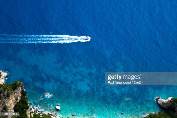 aerial view of sea against blue sky - capri stock pictures, royalty-free photos & images