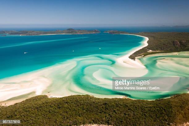 aerial view of sea against clear blue sky - whitehaven beach stock-fotos und bilder