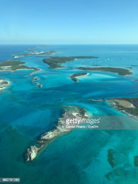 aerial view of sea against clear blue sky - bahamas stock pictures, royalty-free photos & images