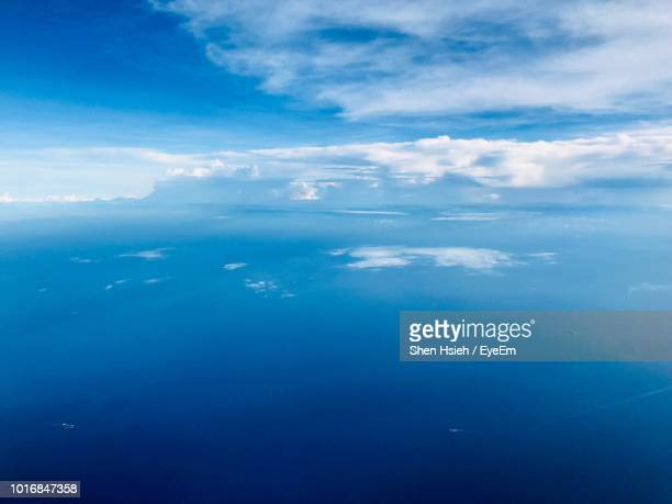 aerial view of sea against cloudy sky - 太平洋 ストックフォトと画像