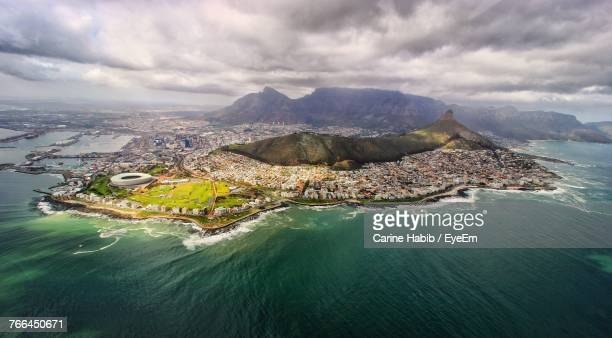 aerial view of sea against cloudy sky - cape town stock pictures, royalty-free photos & images