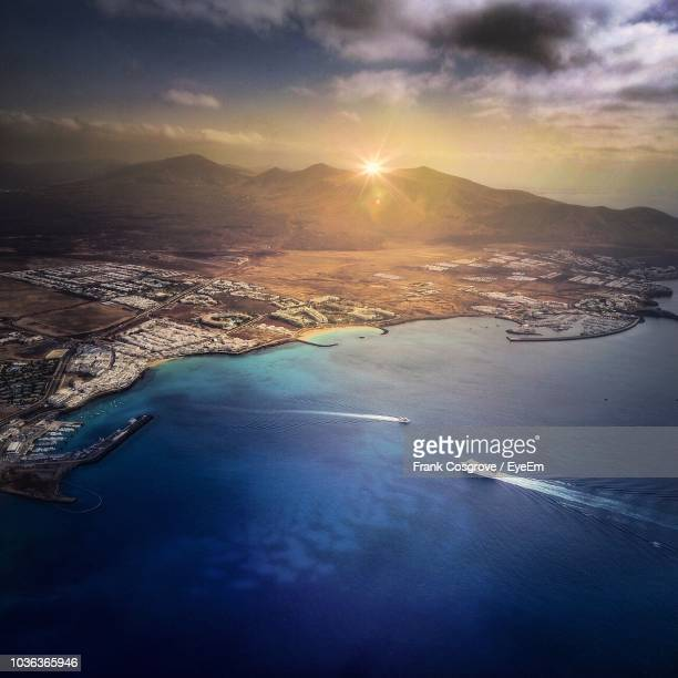 aerial view of sea against sky during sunset - lanzarote stock pictures, royalty-free photos & images