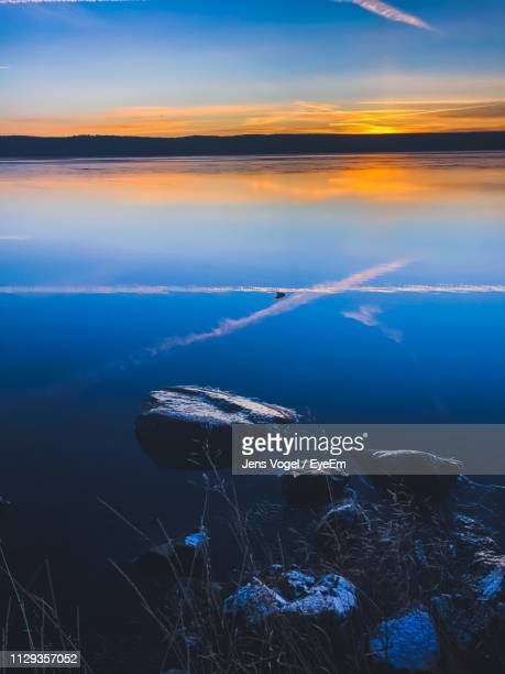 aerial view of sea against sky during sunset - vogel stock pictures, royalty-free photos & images