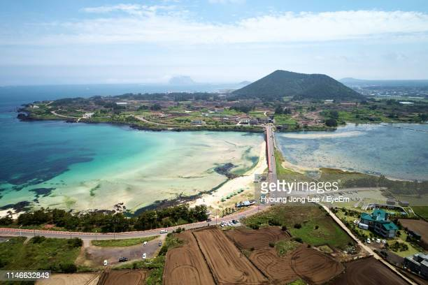 aerial view of sea against sky - jeju island stock pictures, royalty-free photos & images