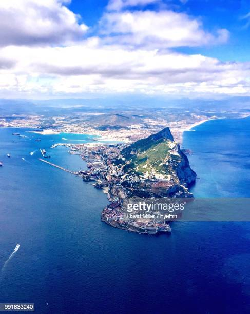aerial view of sea and cityscape against sky - gibraltar stock pictures, royalty-free photos & images