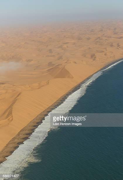 Aerial view of sea and dunes, Namib Desert, Namibia