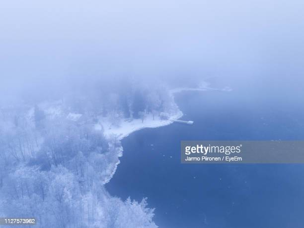 aerial view of sea and forest during winter - turku finland stock photos and pictures
