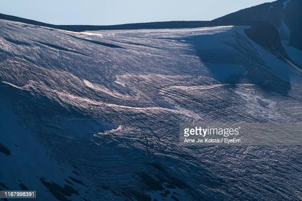 aerial view of sea and mountain against sky - arne jw kolstø stock pictures, royalty-free photos & images