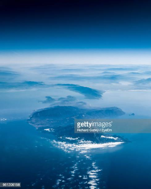 aerial view of sea and mountains against blue sky - samos stock photos and pictures