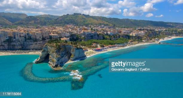 aerial view of sea and mountains against sky - calabria stock pictures, royalty-free photos & images