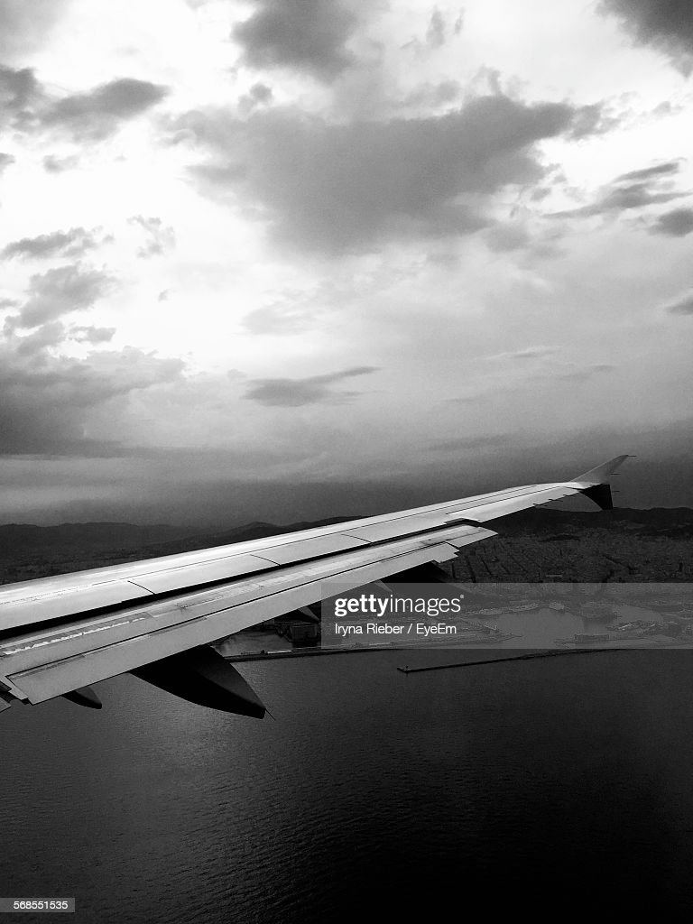 Aerial View Of Sea And Wing Seen Through Airplane Window : Stock Photo