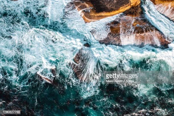 aerial view of sea waves, camps bay beach, south africa - republik südafrika stockfoto's en -beelden