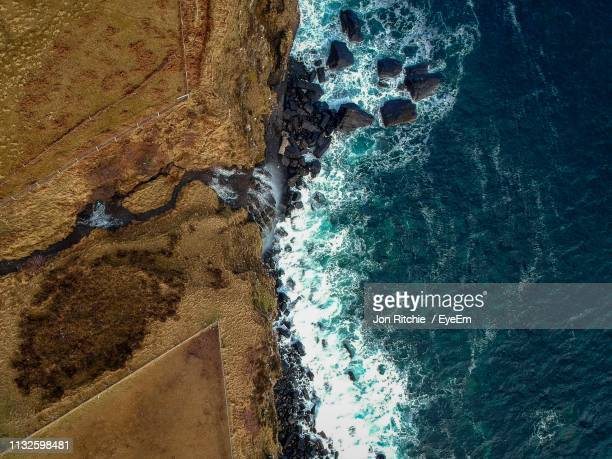 aerial view of sea with rocky coastline - rocky coastline stock pictures, royalty-free photos & images