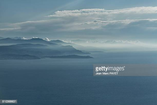 Aerial view of seascape, coast and mist