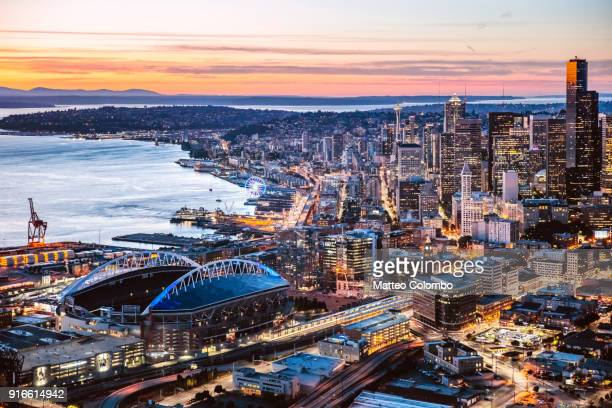 aerial view of seattle downtown and harbor at dusk, usa - washington state stock pictures, royalty-free photos & images
