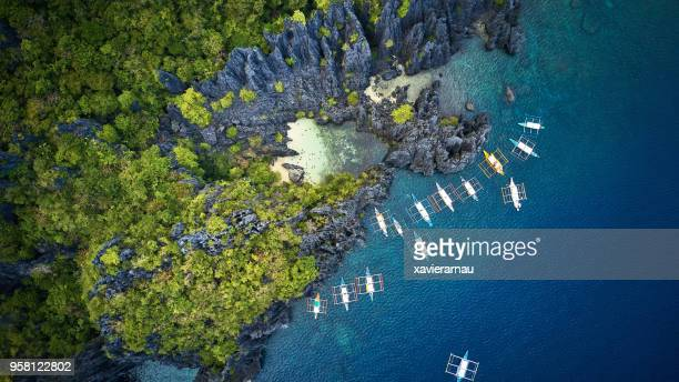 aerial view of secret beach, palawan, philippines - pacific islands stock pictures, royalty-free photos & images