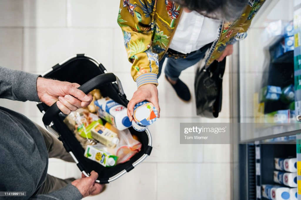 Aerial View Of Senior Couple Picking Out Groceries : Stock Photo