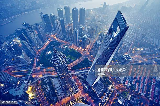 aerial view of shanghai at night - china stock pictures, royalty-free photos & images