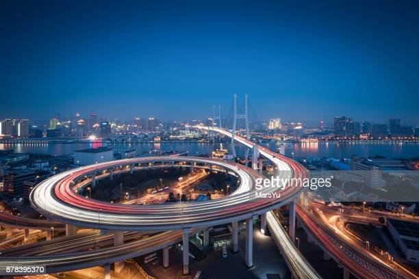 aerial view of shanghai bridge at night - flyover stock pictures, royalty-free photos & images