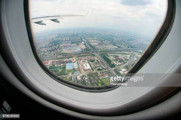 aerial view of shanghai city building and highway,looking from taking off airplane window