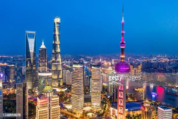 aerial view of shanghai city skyline at dusk - shanghai foto e immagini stock