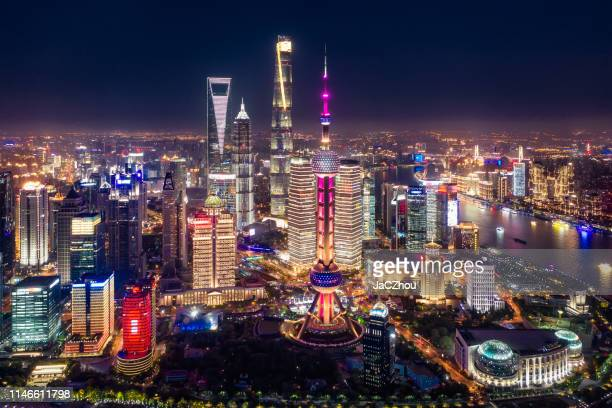 aerial view of shanghai city skyline at night - shanghai stock pictures, royalty-free photos & images