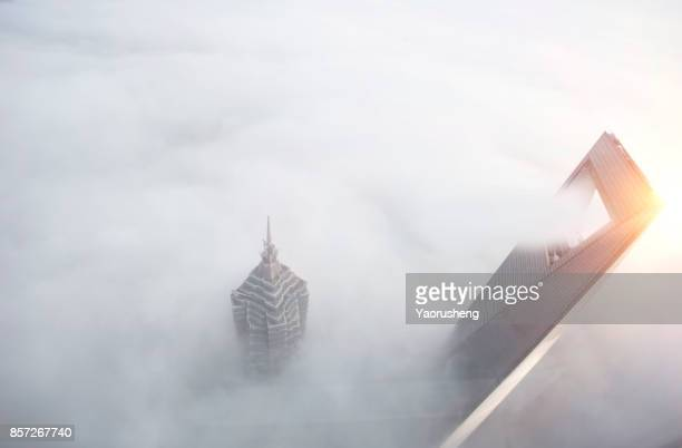 aerial view of shanghai city,in a foggy day - prosperity stock photos and pictures