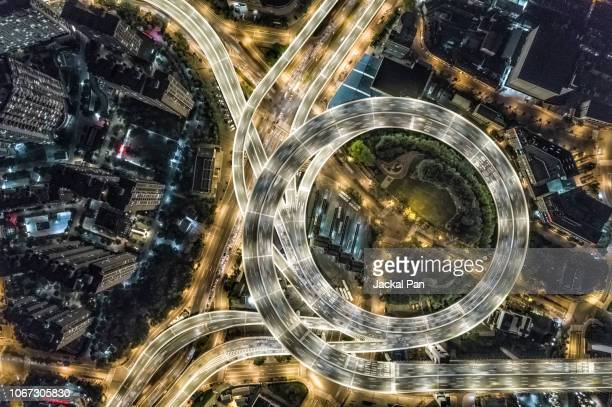 aerial view of shanghai highway at night - stadtviertel stock-fotos und bilder