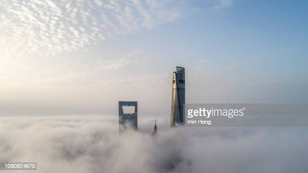 aerial view of shanghai lujiazui financial district in fog - china east asia stock pictures, royalty-free photos & images