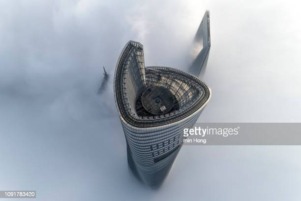 aerial view of shanghai lujiazui financial district in fog - lujiazui stock pictures, royalty-free photos & images