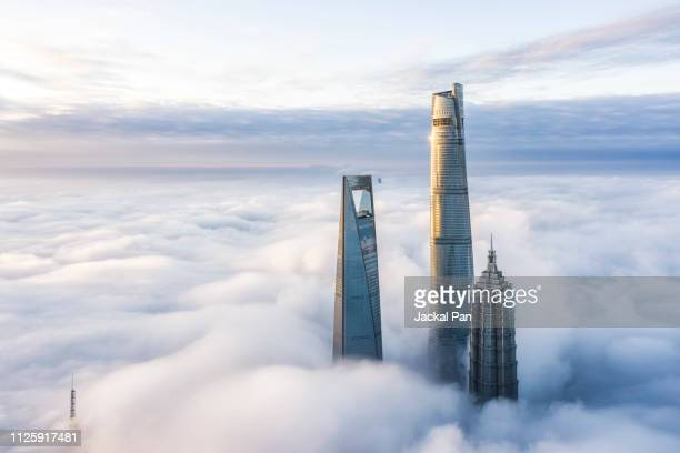 aerial view of shanghai lujiazui financial district in fog - wolkenkratzer stock-fotos und bilder