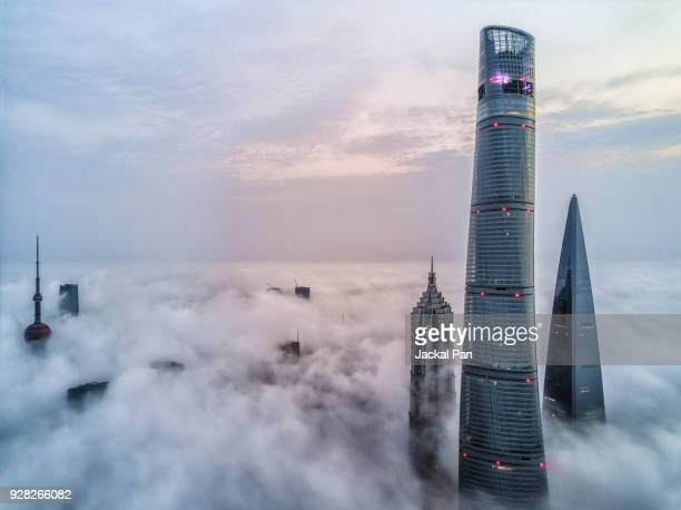 aerial view of shanghai lujiazui financial district in fog - international landmark stock pictures, royalty-free photos & images