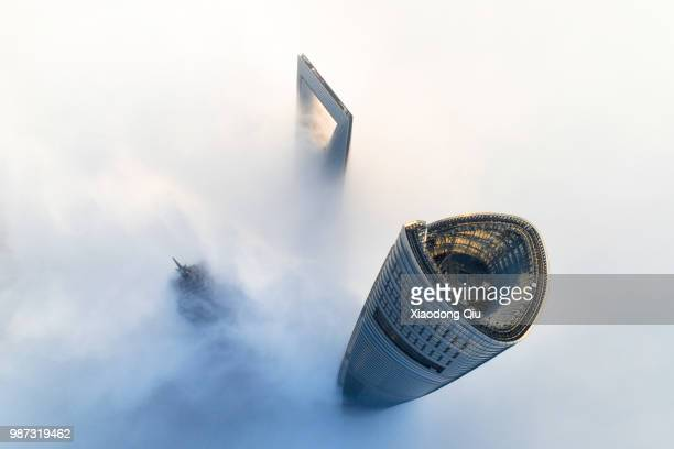aerial view of shanghai lujiazui  in clouds - wolkenkratzer stock-fotos und bilder