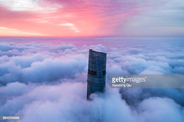 aerial view of shanghai lujiazui  in clouds - international landmark stock pictures, royalty-free photos & images