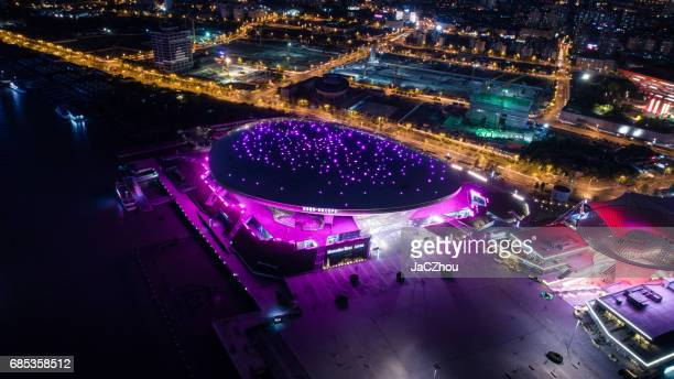 aerial view of shanghai mercedes-benz arena at night - sports venue stock pictures, royalty-free photos & images